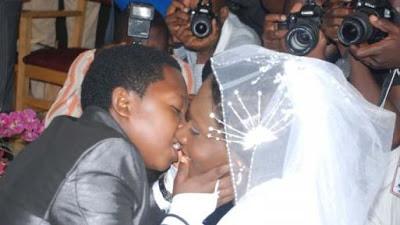WEDDING OF THE WEEK :CHINEDU IKEDIEZE KISSING HIS BEAUTIFUL WIFE