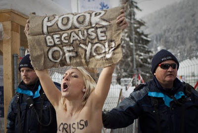 NEWS OF THE DAY:3 TOPLESS PROTESTERS ARRESTED IN SWITZERLAND